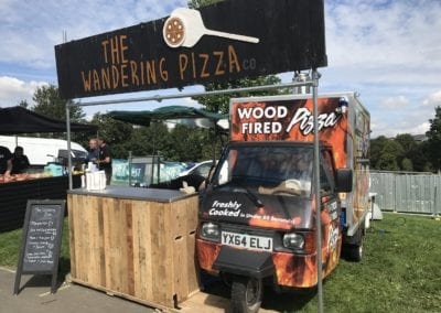 Piaggio Truck set up to serve pizza at an event