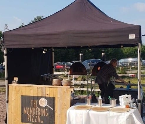 The wandering pizza gazebo with portable wood-fired pizza ovens in a streetfood setup